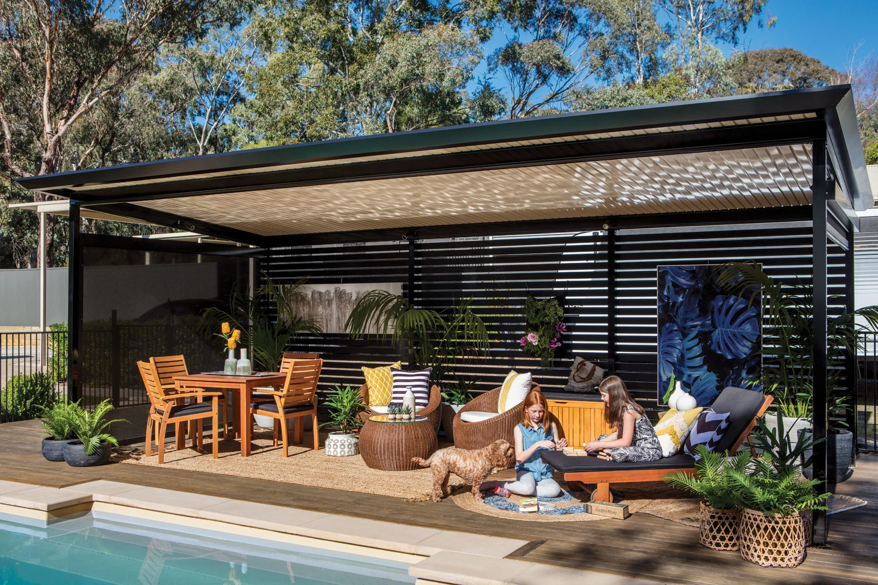 Make things warm and cozy with fire pits, rugs, and pillows galore